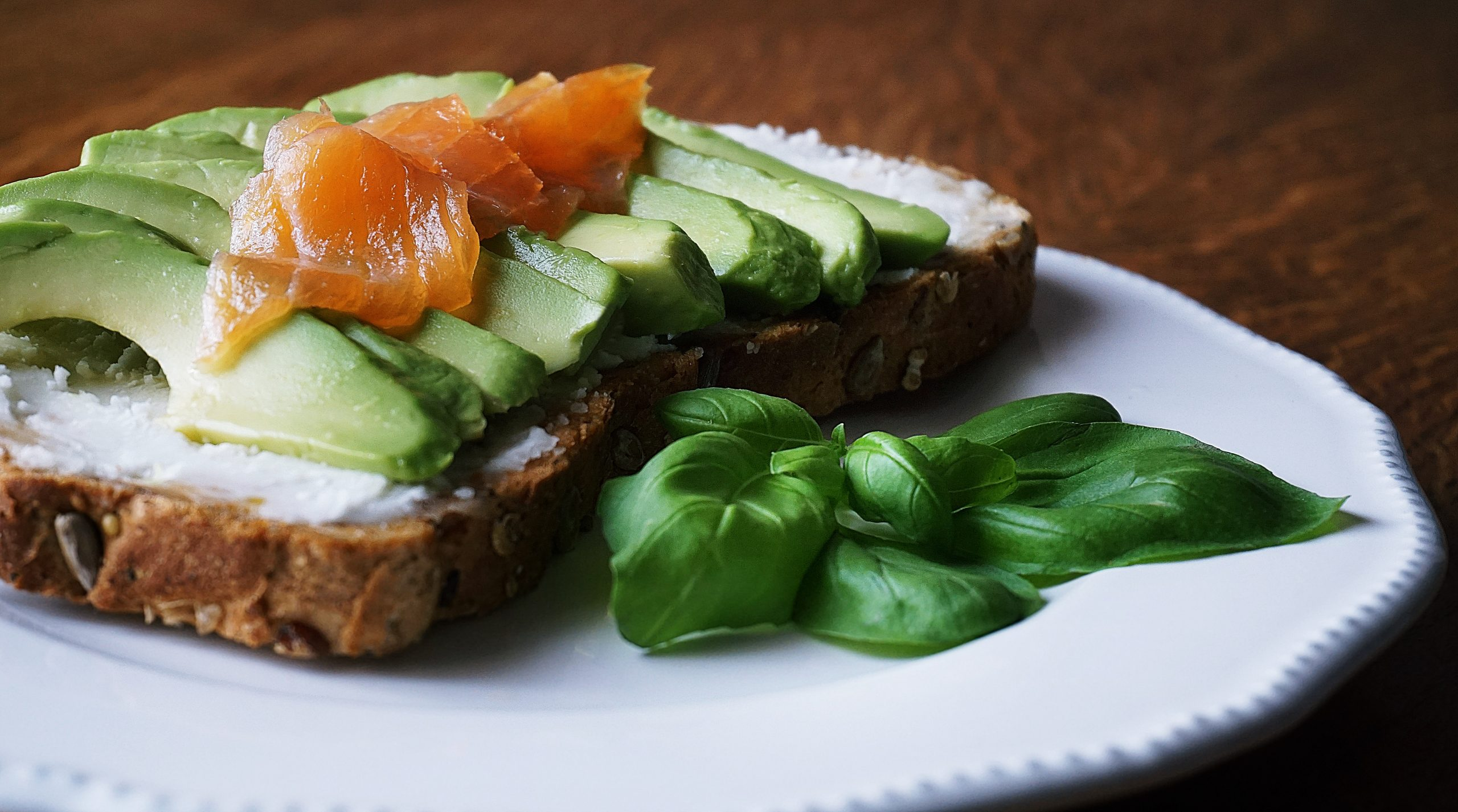 bread with sliced avocado and salmon near basil mint on 2072867 scaled